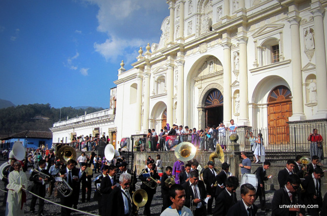 Procession marching in front of San Jose Cathedral - holy week photos Antigua Guatemala