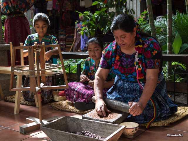 Maya Woman Grinding Coffee by Hand