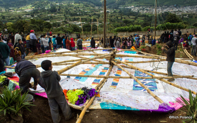 preparing to raise up a giant kite in guatemala