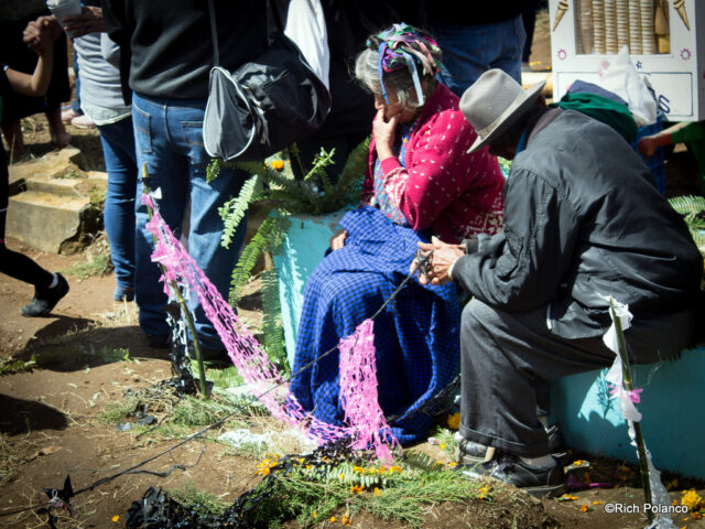 couple grieving at giant kite festival in Santiago Sacatepequez guatemala