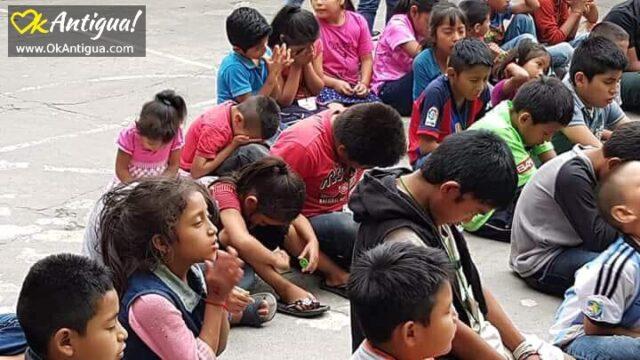 survivor children from Fuego's eruption praying